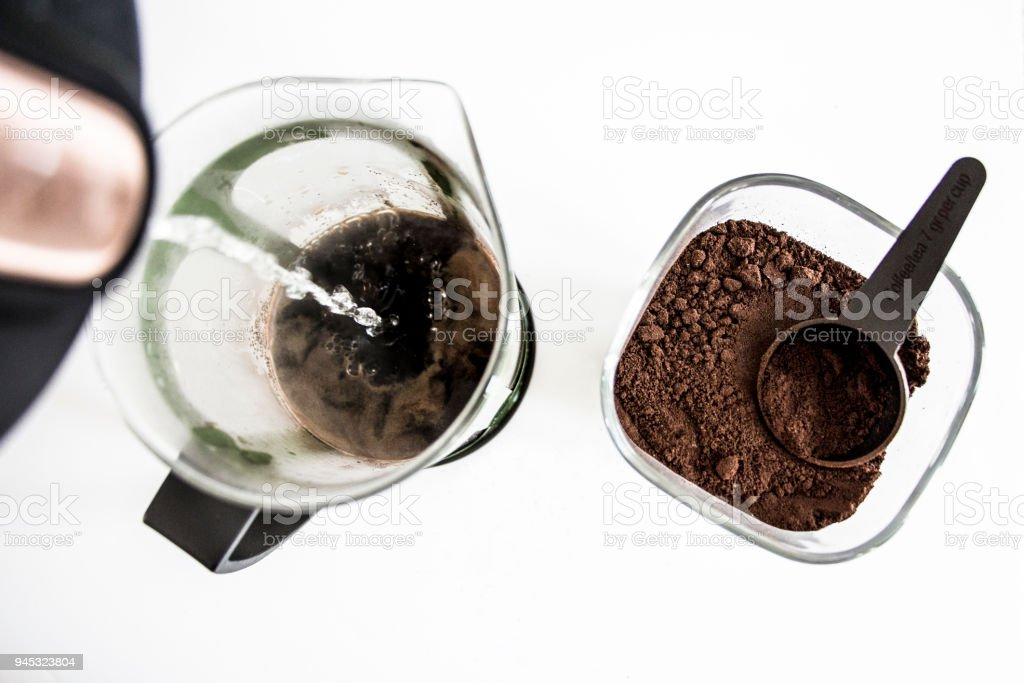 Making coffee in a french press on a white background stock photo