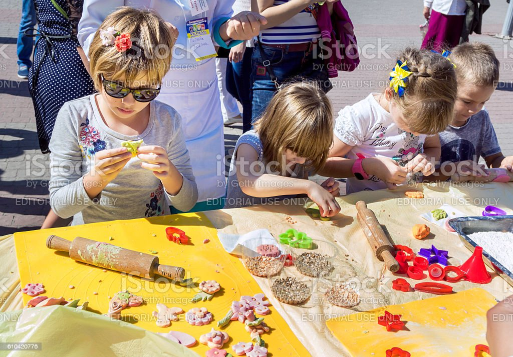 making colorful paste figures for cookies decoration - Photo