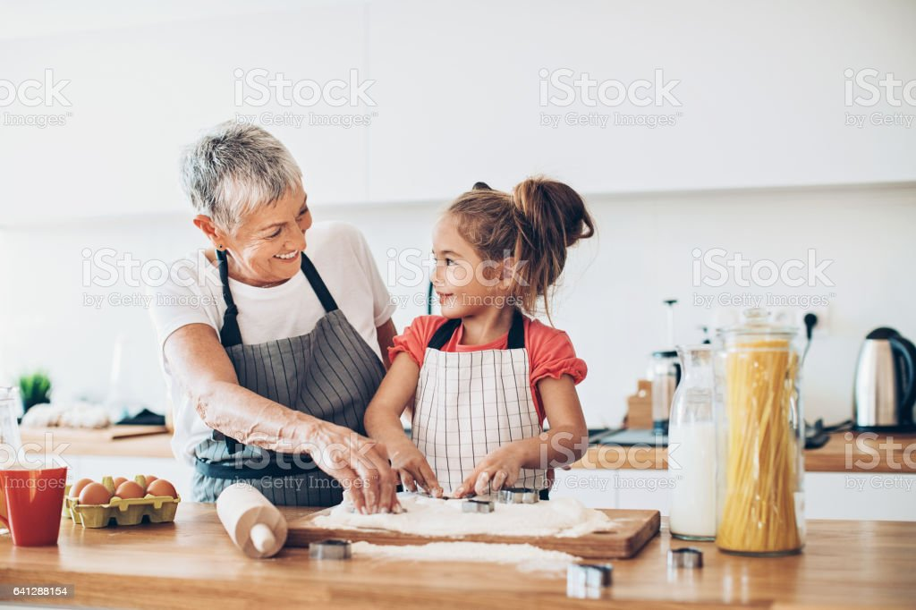 Making cookies with grandma stock photo