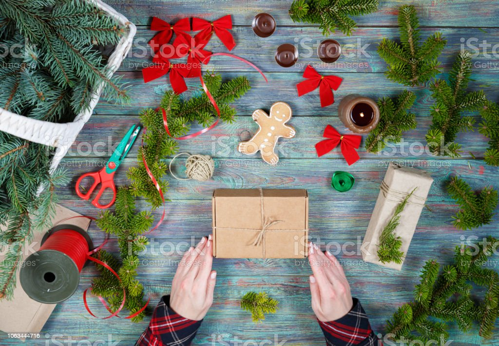 Making craft creative gift boxes, woman decorating Christmas presents...
