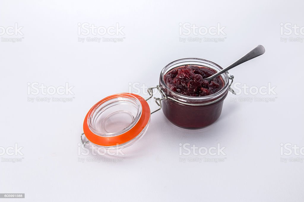 Making cranberry relish/sauce, a small filled kilner style jar stock photo