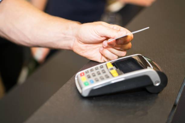 making credit card payment closeup - paying with card contactless imagens e fotografias de stock