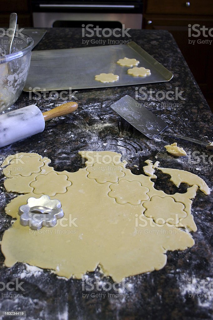 Making Cut-Out Cookies 1 Vertical royalty-free stock photo
