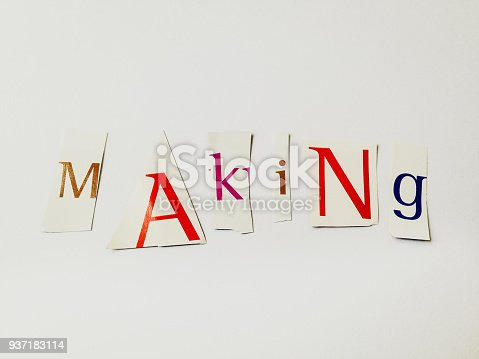 812461124istockphoto Making - Cutout Words Collage Of Mixed Magazine Letters with White Background 937183114
