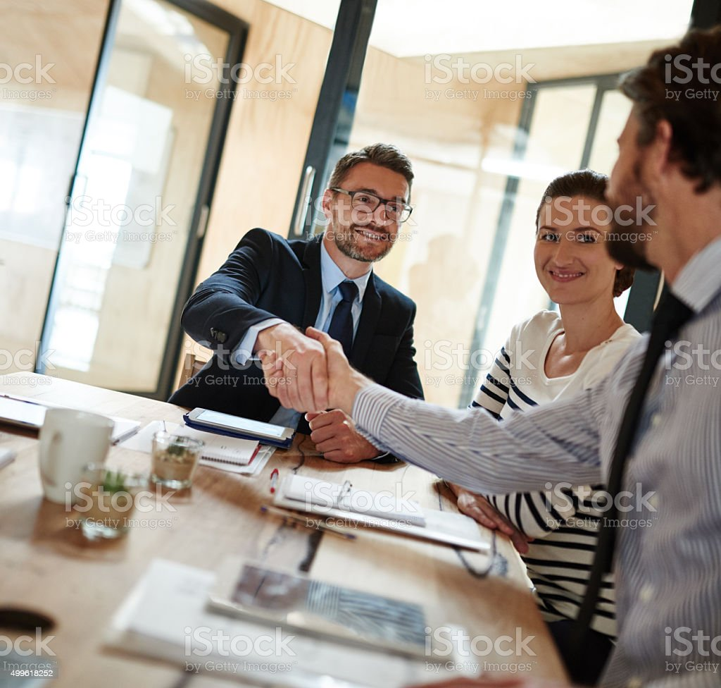Making deals in the boardroom stock photo