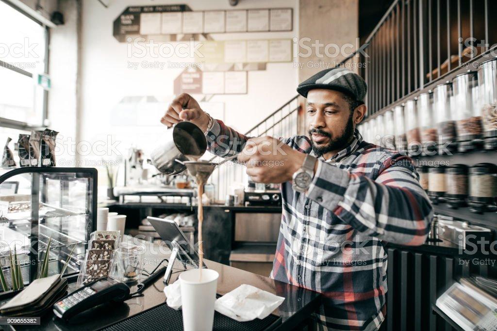 Making delicious tea at tea bar stock photo