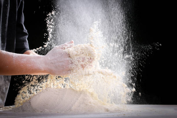 Making dough by female hands at home in kitchen – Foto