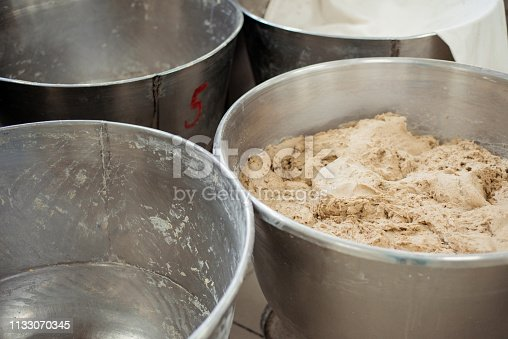 istock Making dough for bread in a bakery 1133070345