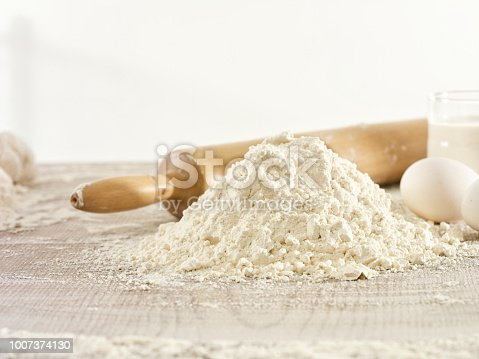Close up dough making scene with rolling pin