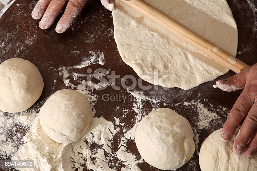 istock Making dough 694145672