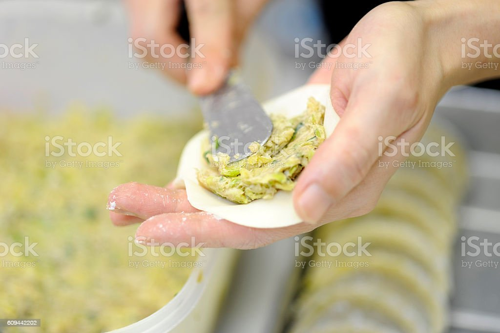 Making dumplings stock photo