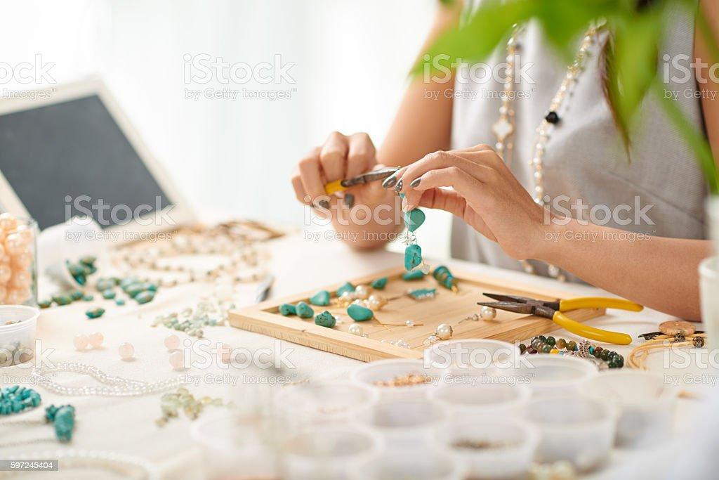Making earrings stock photo
