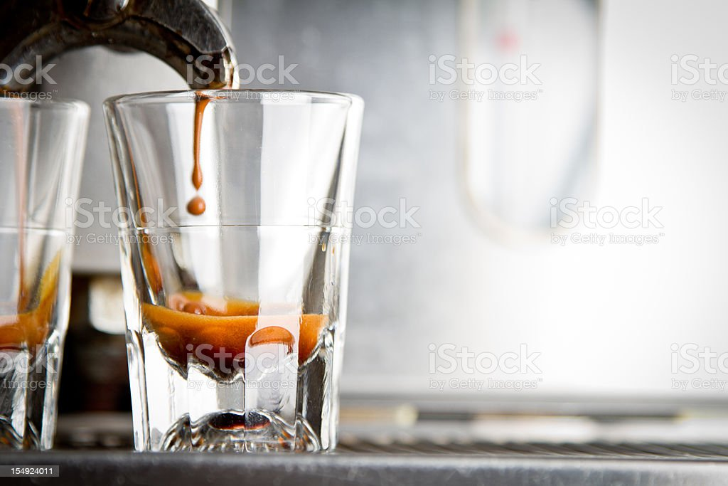 Making Espresso in a Coffee Shop stock photo