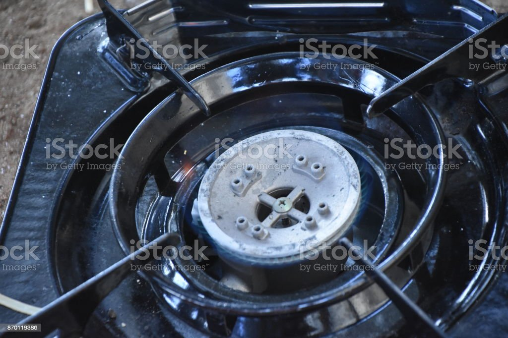 Making food on a gas stove stock photo
