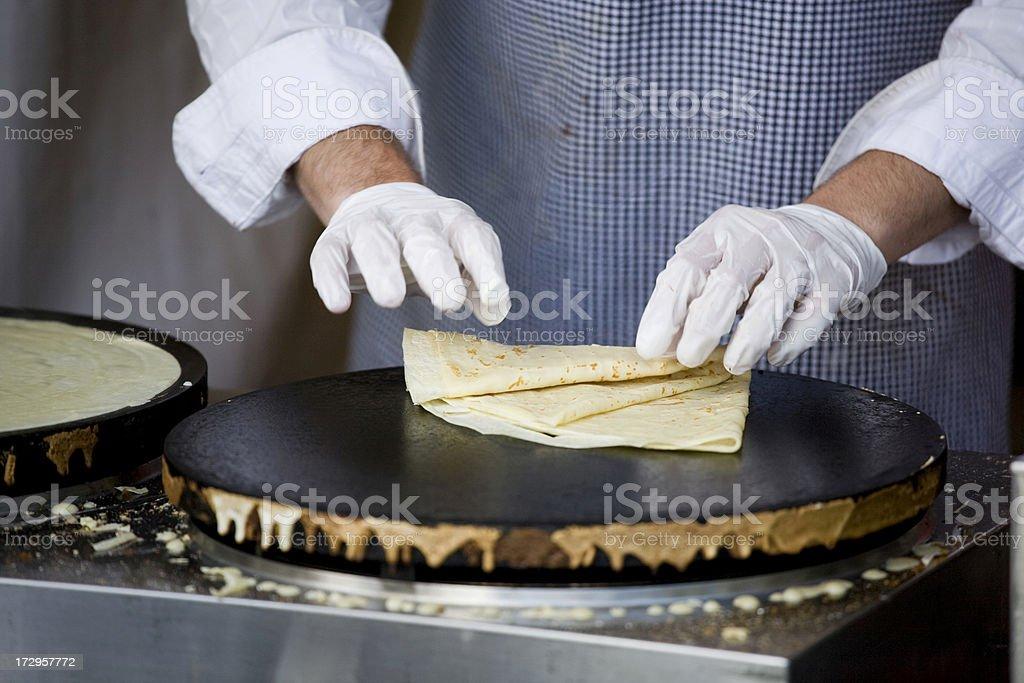 Making fresh crepes at a farmers market royalty-free stock photo