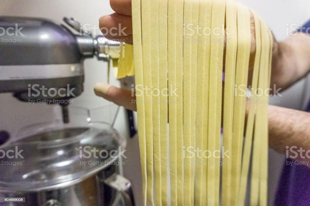 Making Fresh Pasta Fettuccine stock photo