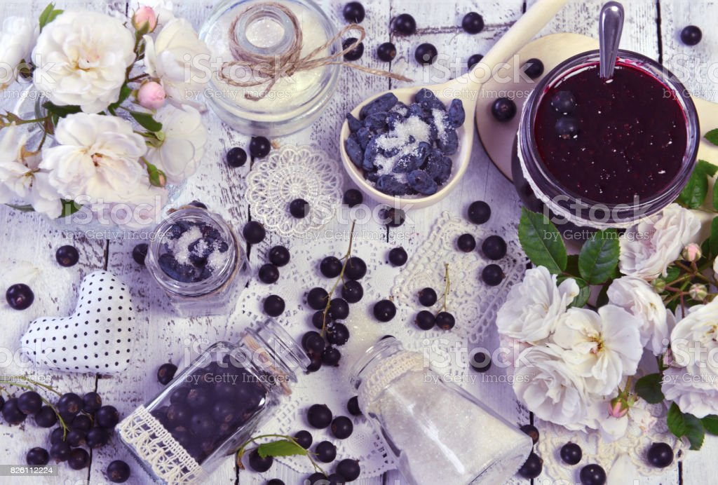 Making fruit jam concept with sugar and fresh berry stock photo