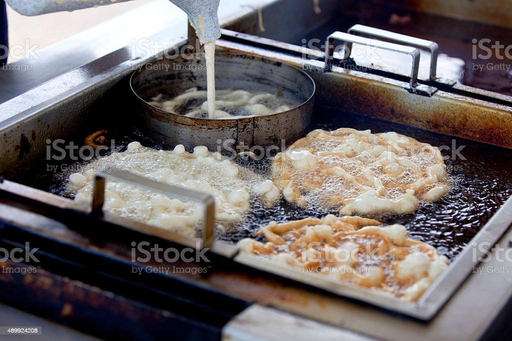 Making Funnel Cake stock photo