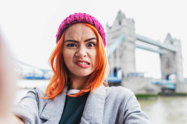 making funny faces for a selfie - uk travel stock photos and pictures