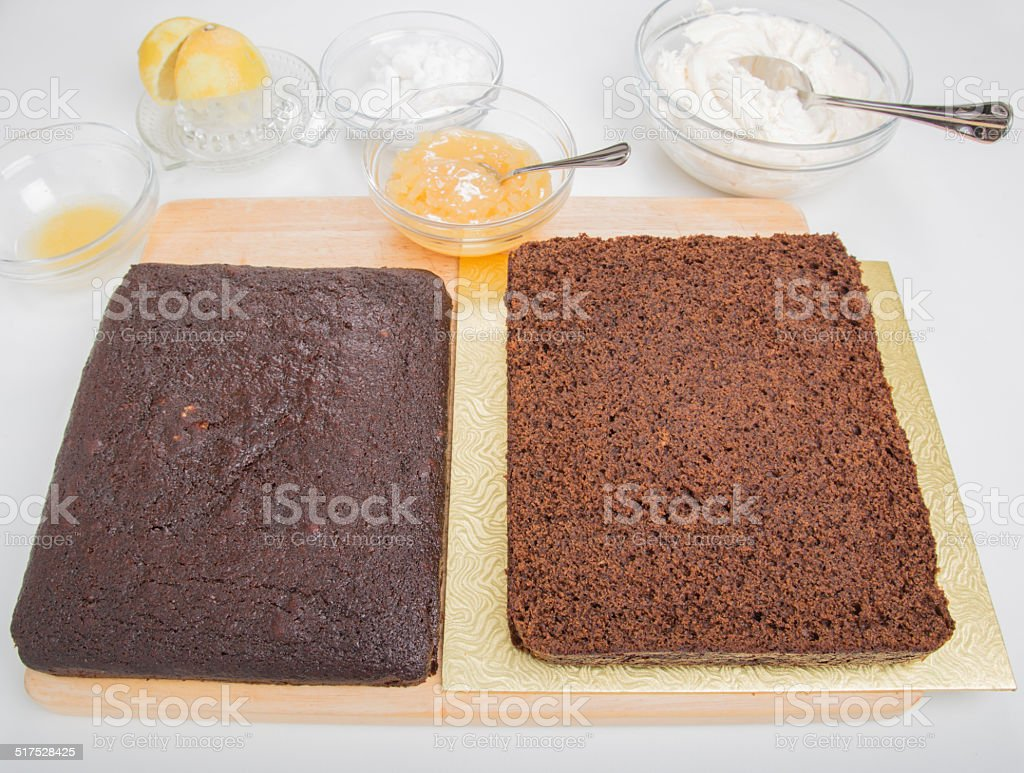 Making ginger bread cake,cake cut horizontally ready to ice stock photo