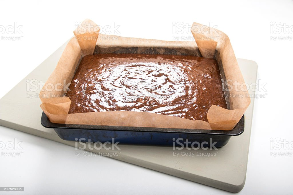 making gingerbread, cake batter in tin ready to cook stock photo
