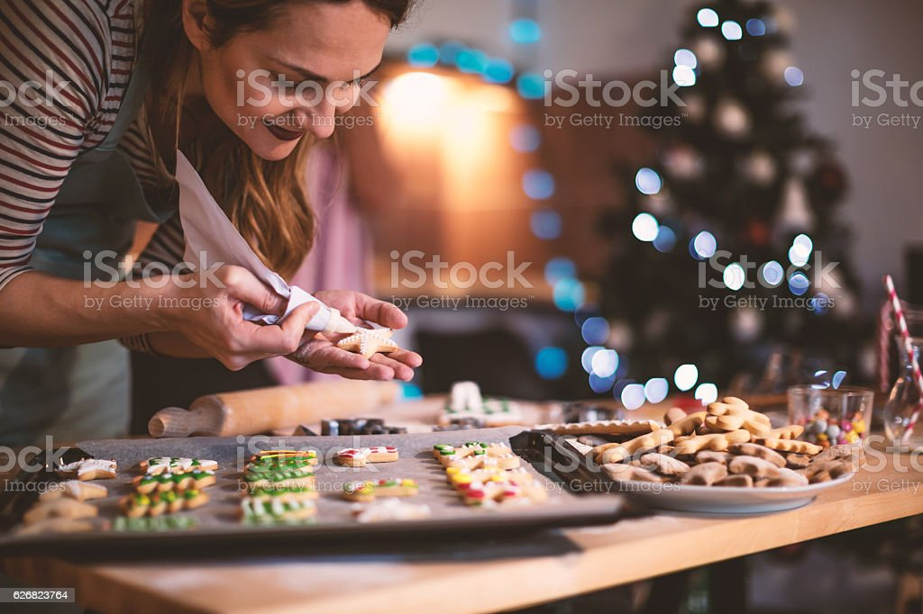 Making Gingerbread cookies for Christmas stock photo