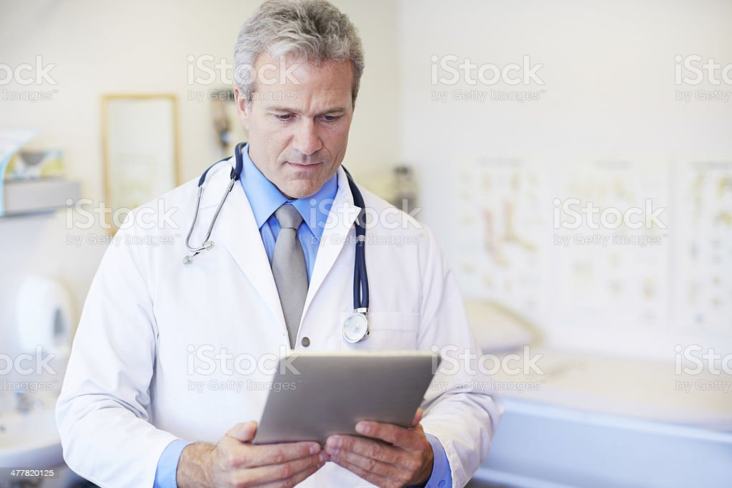 Making good use of technology in his profession royalty-free stock photo