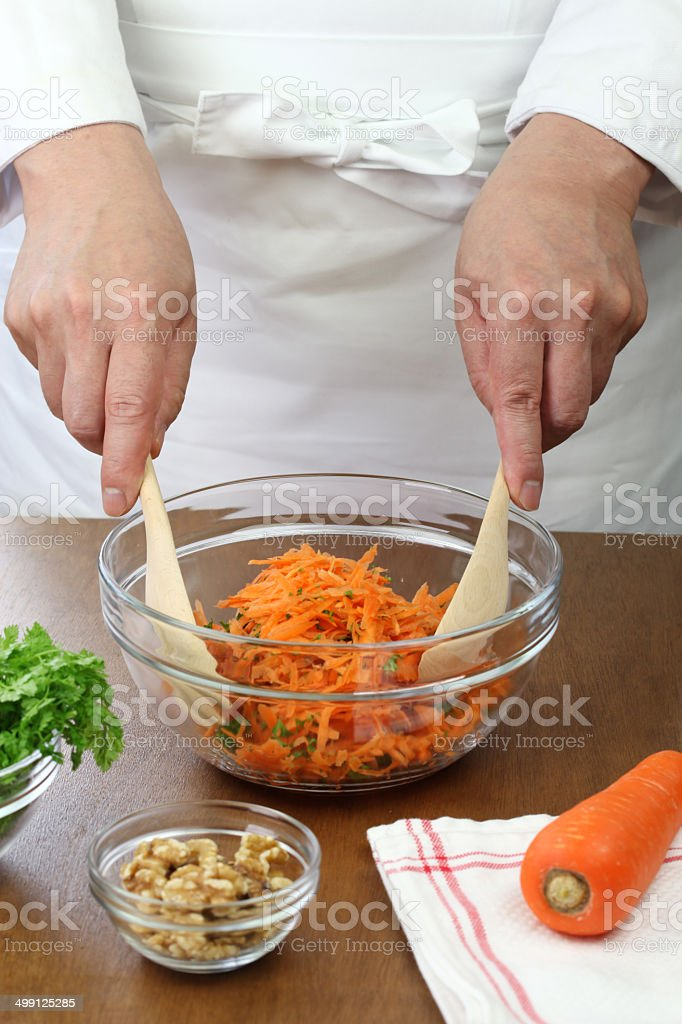 making grated carrot salad stock photo