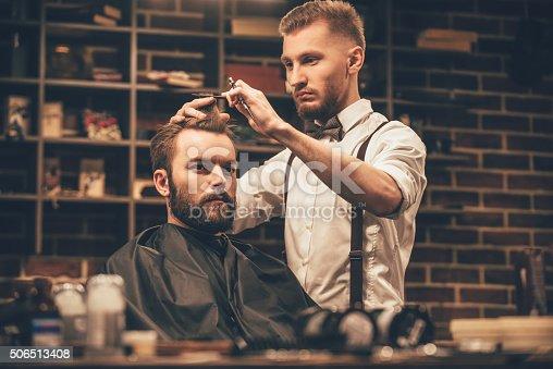 986804130istockphoto Making haircut look perfect. 506513408