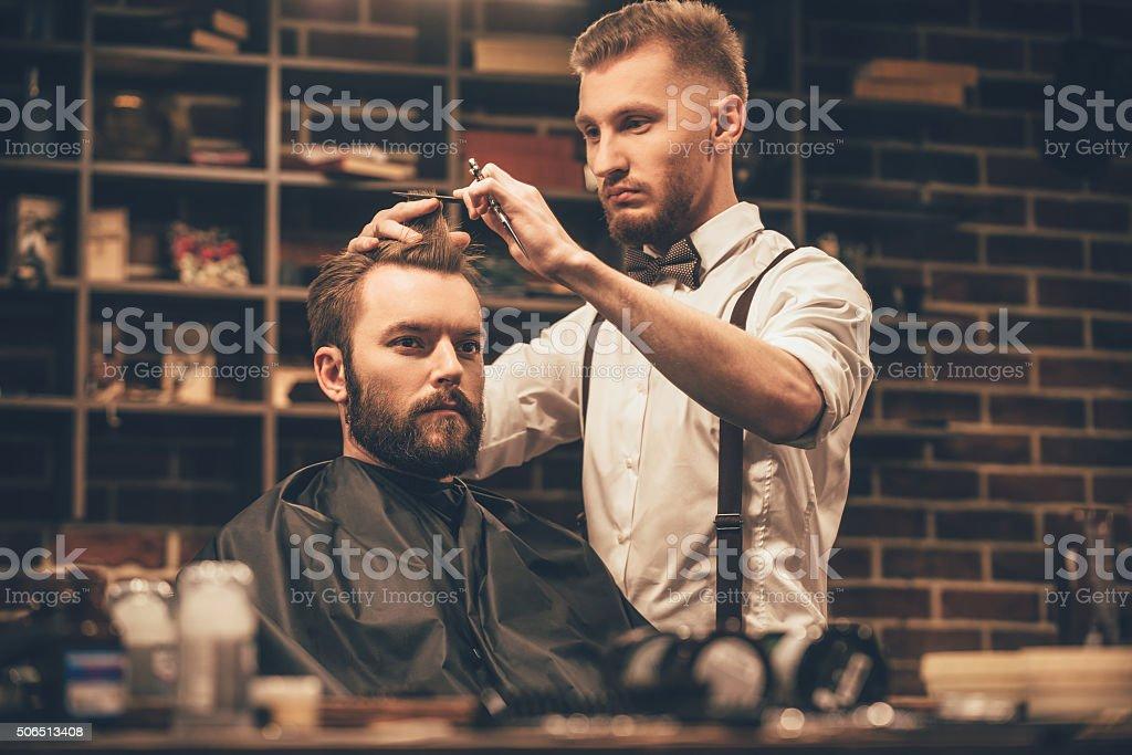 Making haircut look perfect. stock photo