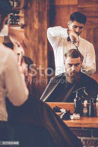 986804130istockphoto Making haircut look perfect. 522303468