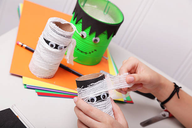 Making Halloween Mummies stock photo