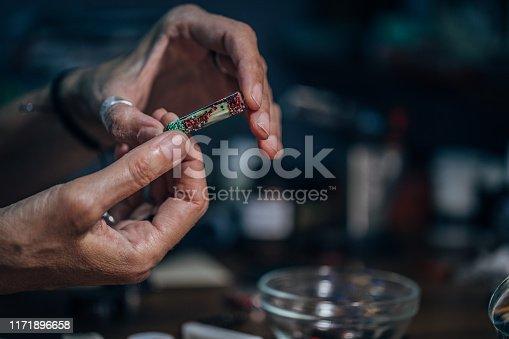 istock Making handmade jewelry 1171896658