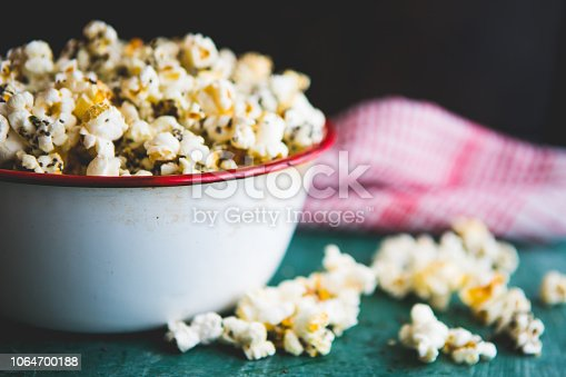 Homemade popcorn filled with spices and grains. Perfect snack for movie days at home.