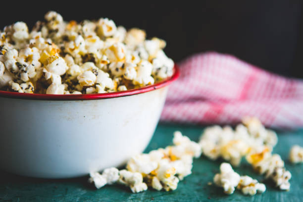 Making Healthy Popcorn At Home Homemade popcorn filled with spices and grains. Perfect snack for movie days at home. yeast stock pictures, royalty-free photos & images