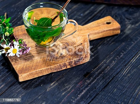 A the cup of lemon balm tea on the wooden table