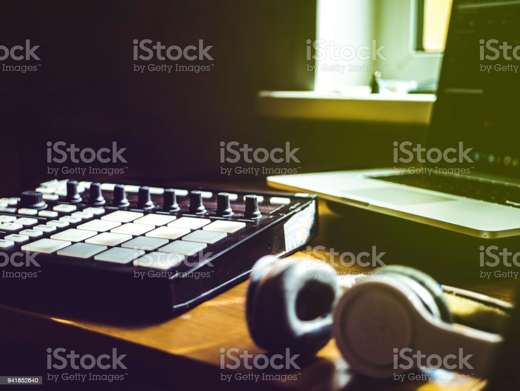making hip hop beats on the drum machine controller at the home studio stock photo