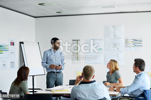 istock Making his presentation to the team 533719118