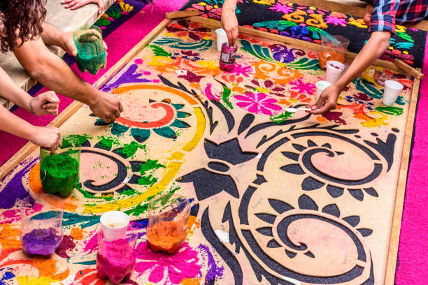 Making Holy Week carpet, Antigua, Guatemala Making dyed sawdust carpet for Holy Thursday procession in colonial town with most famous Holy Week celebrations in Latin America central america stock pictures, royalty-free photos & images