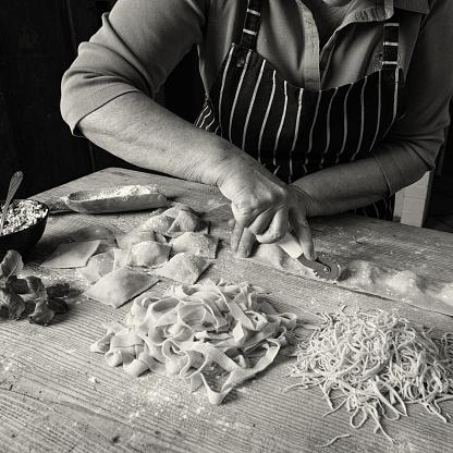 Woman making homemade pasta.