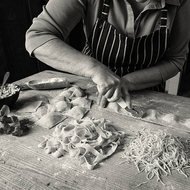 Making Homemade Pasta Woman making homemade pasta. pasta photos stock pictures, royalty-free photos & images