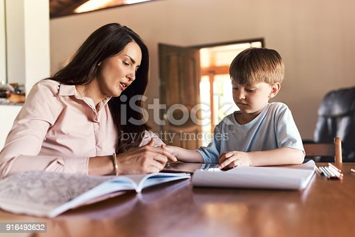 655532196 istock photo Making homework a bonding activity 916493632