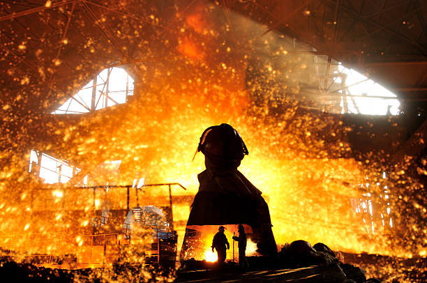 making iron water - metallurgy stock photos and pictures