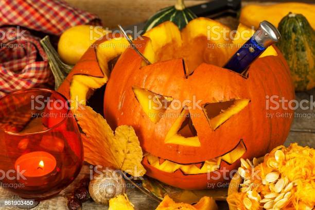 Making Jack O Lantern Carving The Pumpkin Hollowing Out A Scary Pumpkin To Prepare Halloween Lantern Stock Photo - Download Image Now
