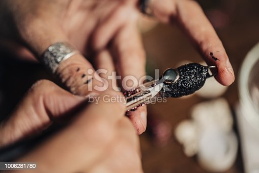 991427116 istock photo Making jewelry accessories 1006281780