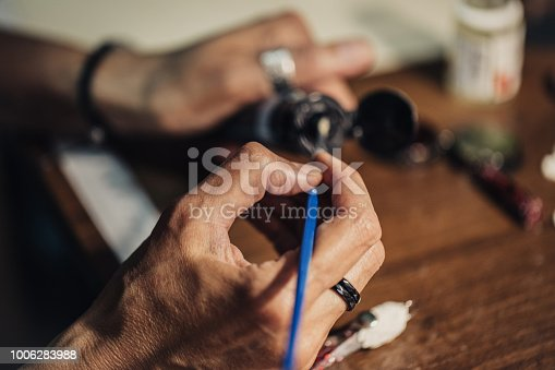 991427116 istock photo Making jewelry 1006283988