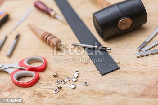 istock making leather belt with tools 1135306447