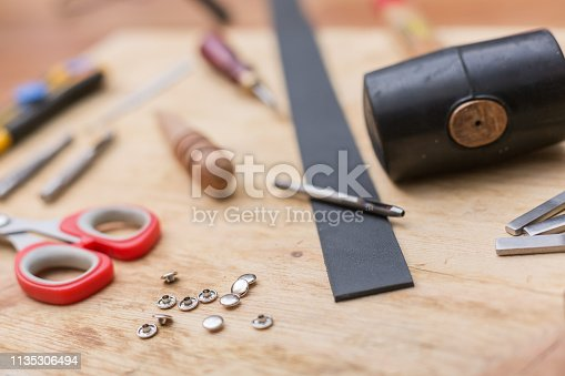 istock making leather belt with tools 1135306494