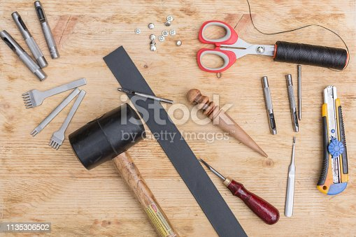 istock making leather belt with tools 1135306502