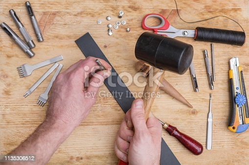 istock making leather belt with tools 1135306512